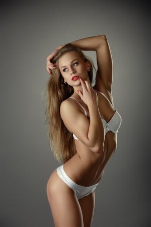 nude blonde girl: Studio shot of gorgeous long-haired model in lingerie Stock Photo