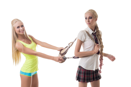 sisters sexy: Sport or study. Photo concept. Beautiful blondes posing at camera