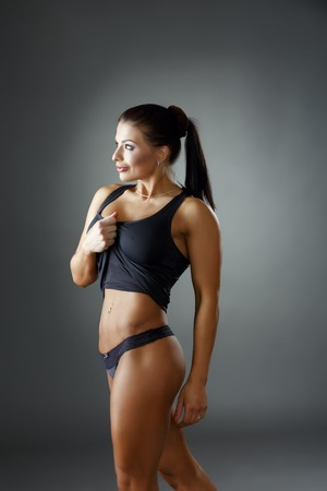 flat stomach: Bodybuilding. Image of sexy brunette shows her flat stomach