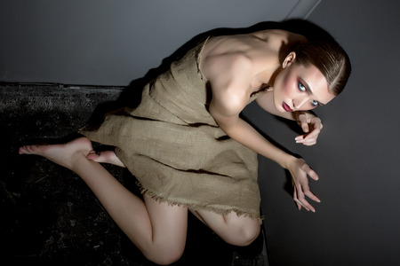 slave girl: Hostage of beauty and fashion. Photo concept. Pretty woman posing at camera