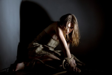 bounded: Concept. Tied with rope model posing as victim of kidnapping