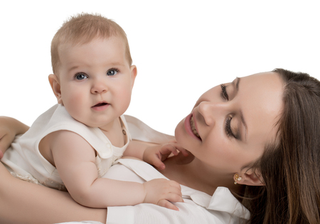 tenderly: Image of happy young mother tenderly holding her daughter Stock Photo