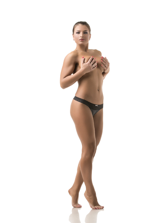 nude: Seductive female athlete posing nude to waist in studio