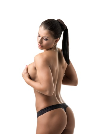 topless brunette: Rear view of sexy topless brunette with fit body Stock Photo