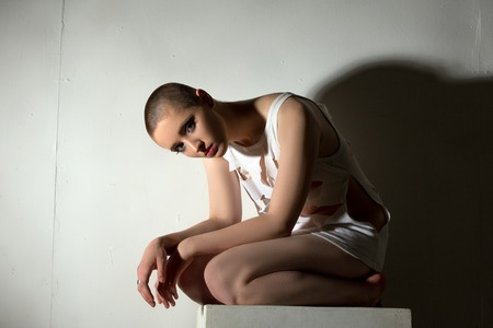 skinhead: Skinhead girl posing as patient of psychiatric clinic