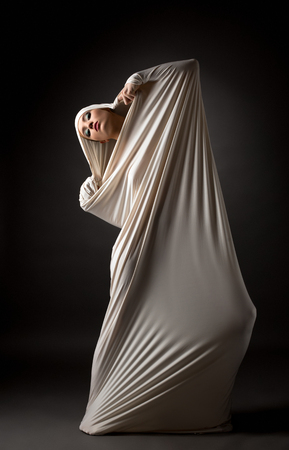 transformed: Fashion concept. Model posing in cocoon as butterfly transformed Stock Photo