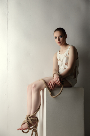 skinhead: Skinhead girl with tied limbs posing as mentally ill person
