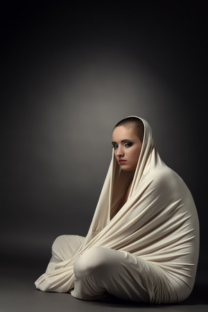 skinhead: Image of girl posing as insane patient in straitjacket Stock Photo