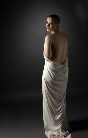 nude women: Image of sad skinhead girl posing back to camera Stock Photo