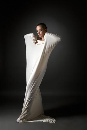 cocoon: Concept of mental disorder. Skinhead girl posing in studio
