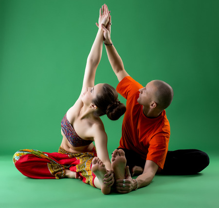 sexual position: Yoga. Studies in tandem with experienced instructor Stock Photo