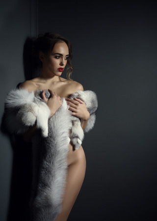 naked sexy girl: Studio photo of beautiful model posing naked with fur