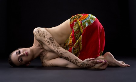 young woman nude: Yoga. Photo of beautiful woman with mehndi patterns