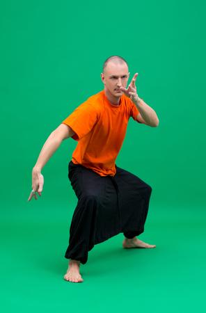 yogi: Studio photo of middle-aged yogi froze in asana Stock Photo