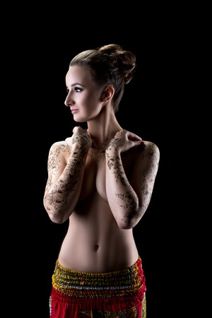 Image of sensual topless woman with henna pattern on her hands