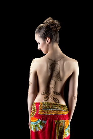 nude brunette: Mehendi. Image of womans back painted with henna Stock Photo