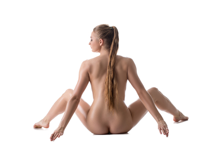 girls naked: Back view of pretty nude girl spreads her legs. Isolated on white