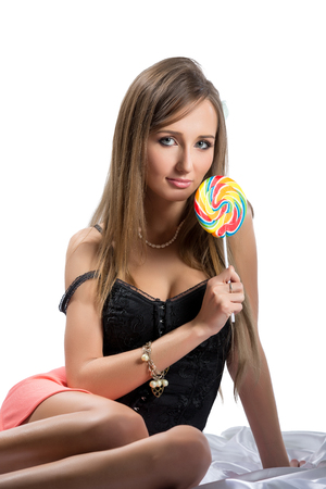 brunette girl: Image of sexy brunette with lollipop, isolated on white Stock Photo