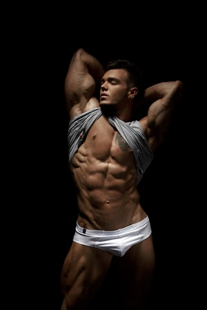 erotic: Bodybuilding and modeling. Image of sexy hunk shows his body