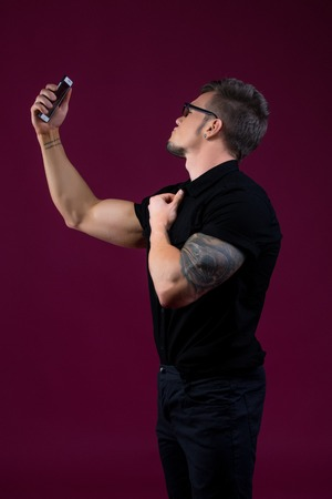 narcissist: Image of stylish bodybuilder doing selfie with smartphone
