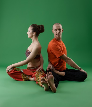 sexual position: Man and woman practicing yoga in pair. Studio image Stock Photo