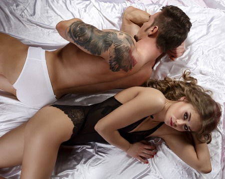 young couple sex: Sex crisis. Pretty girl posing upset, her partner ignores
