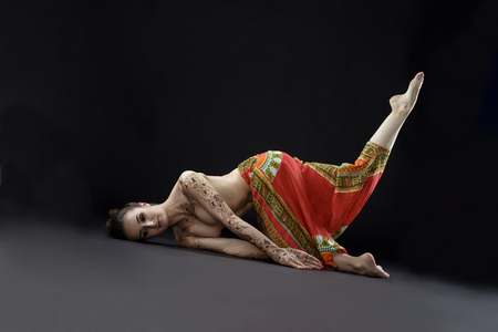 young girl nude: Mehendi and yoga. Studio photo of woman doing asana in studio
