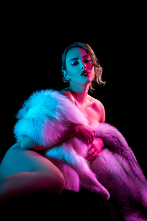 hot girl nude: Elegant girl covers her nakedness with luxurious coat Stock Photo