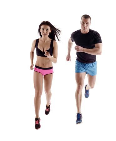 sportsman: Foto de estudio de corredores hermoso que presenta a la cámara, aislado en blanco