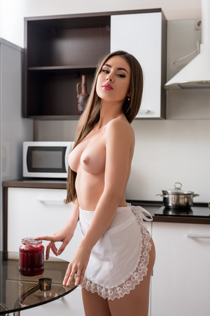 girls breast: Image of beautiful topless model wearing maids apron in kitchen