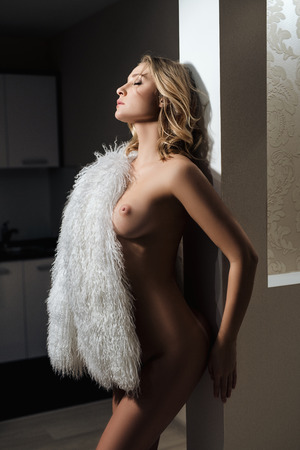 nude babe: Image of nude blonde with perfect body wearing fur