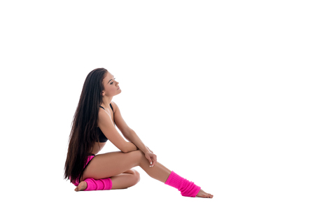 gaiters: Sport fashion. Image of pretty brunette in pink gaiters