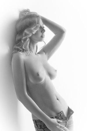 topless women: Black and white drawing of sensual topless woman posing leaning against wall