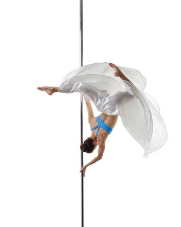 harmonous: Graceful pole dancer posing in difficult turn. Isolated on white Stock Photo