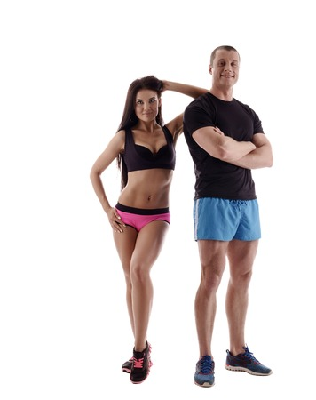 promotes: Handsome couple promotes sport lifestyle. Studio photo, isolated on white