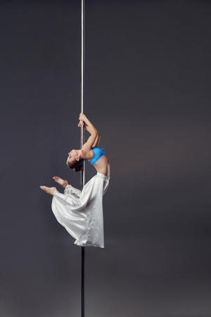 harmonous: Image of sexy dancer bent gracefully while dancing on pylon