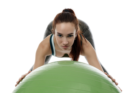 sportive: Image of pretty blue-eyed girl training with fitness ball