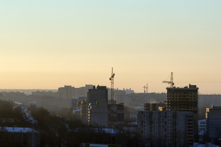 concrete commercial block: Construction of new apartment buildings in early morning Stock Photo
