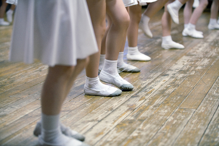 white socks: Young girls in ballet school. Image of legs, close-up
