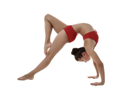 gimnasia: Imagen de la muchacha flexible, haciendo pose gimnástica, aislada en blanco Foto de archivo