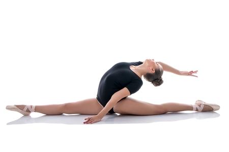 Image of pretty ballerina gracefully performs splits