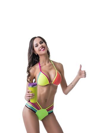 mujeres jovenes desnudas: Mujer feliz con la carrocería perfecta muestra pulgar. Aislado en blanco