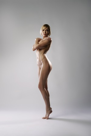 girls naked: Image of naked blonde with perfect body posing at camera