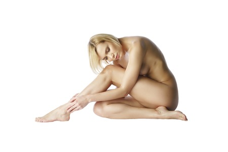 sexy topless women: Nude blonde sitting with her eyes closed. Isolated on white background