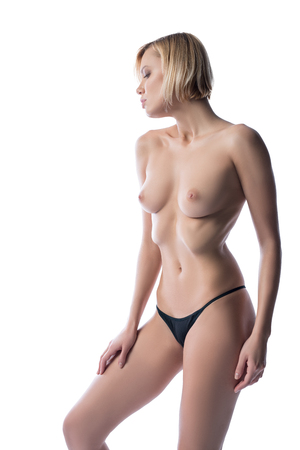 beautiful nude woman: Studio photo of topless blonde posing while sucked in her abdomen
