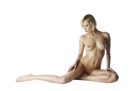 Nice blonde with perfect body posing completely naked Stock Photo