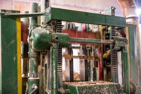 sawdust: Image of machine sawing wood and sawdust flying