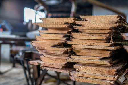 Woodworking plant. Image of boards stacked in pile Stockfoto