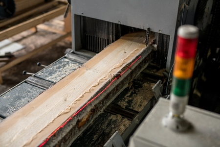 lumber mill: At sawmill. Image of sawing wood with laser marks, close-up
