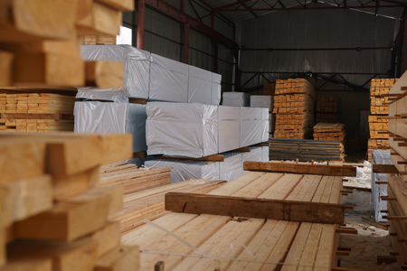Warehouse at sawmill. Image of stacked wooden boards